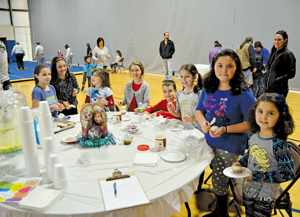Children enjoy decorating cupcakes at last year's Winterfest.