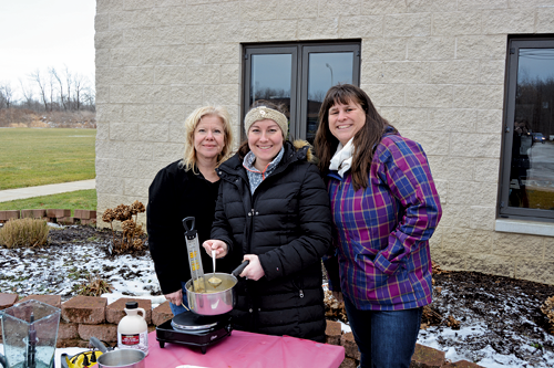 Wheatfield Town Clerk Kathleen Harrington-McDonell (left) prepares to make maple taffy with her daughter, Nicole Cheff (center) and Renee Torcasio at last year's Winterfest.