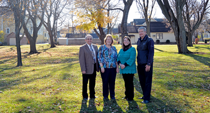 Pictured are North Tonawanda Mayor Arthur Pappas and Children's Remembrance Gardenwalk committee members at the future gardenwalk's site.