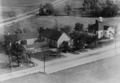 Aerial shot of Grand Island, circa 1950s, with Baseline Road in the foreground and the Express Highway (now Grand Island Boulevard) in back. The Town Hall and garage are to the left in the photo, and School No. 9, at Whitehaven and Baseline, is on the right. Click for a larger image.