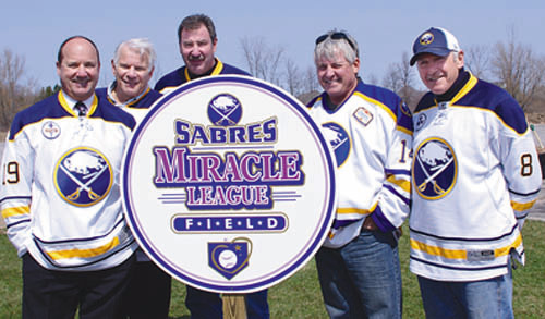 The new ball diamond was christened Sabres Miracle League Field to denote the contribution of the Buffalo Sabres hockey organization and its players alumni. At the groundbreaking, seven former Sabres greats were on hand to help usher in a new era on the Island, including, from left, Derek Smith, Mike Robitaille, Larry Playfair, Rene Robert and Jim Lorentz.