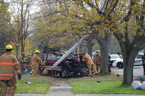 Grand Island Fire Co. rescue personnel work at the scene of a one-car accident on Baseline Road Nov. 11, where at 1 p.m. a vehicle ran head-on into a telephone pole and tree. (photo by Larry Austin)