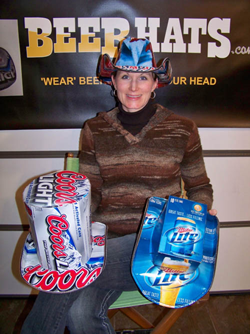 Cyndy Montana shows some of the beerhats made on the Island at the company owned by her and her husband, Pete. (photo by Brian Kahle)