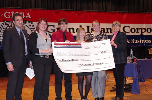 Grand Island High School Vice Principal Michael Lauria and Grand Island Town Supervisor Mary Cooke presented the winning check to Bennie and the Jets - Lydia Bernativicz, Sam Clarke, Bridget Kennedy and Courtney Collignon - after winning the 2013 Corporate Bowl. (photo by Larry Austin)