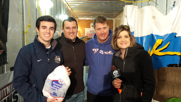 Pictured, from left, Kurt Villani Jr., Kurt P. Villani, Dave `D.J.` Jickster, Channel 7 news anchor Joanna Pasceri donate turkeys at `Rock Out Hunger` to benefit the Food Bank of WNY.