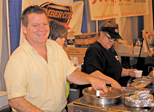 Mike Carr, owner of the Village Inn (1488 Ferry Road on Grand Island), served lemon Tabasco chowder, butternut squash, and Mayan chocolate chili. The Village Inn's chili was an award-winner at the festival.
