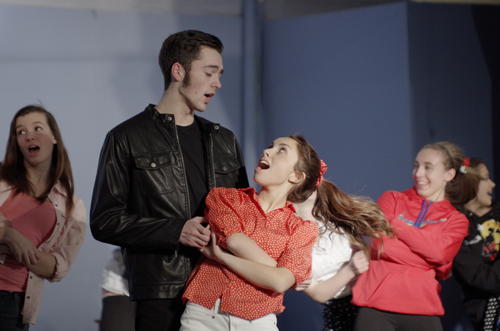 Pictured, teen heartthrob Conrad Birdie (played by Jared Eichel) dances with Kim (Natalie Baldassarre), the winner of `one last kiss` from Birdie before he leaves for the Army.