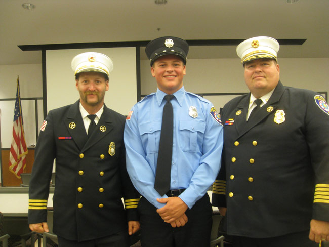 Cadet Sean O'Donnell is flanked by Grand Island Fire Co. Assistant Chief Matt Osinski, left, and at the graduation ceremony.