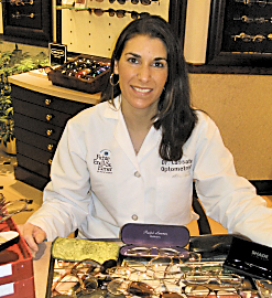 Dr. Adrienne Cassata, an optometrist at Fichte Endl & Elmer Eyecare, sorts donated eyeglasses that she will take with her on a mission trip to the Dominican Republic in January.
