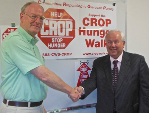 Coordinator of Grand Island CROP Walks the Rev. Paul Robinson congratulates Robert Christmann, Grand Island superintendant of schools, who will serve as the honorary chairperson of this year's Grand Island CROP Walk, which takes place Sunday, Oct. 14.