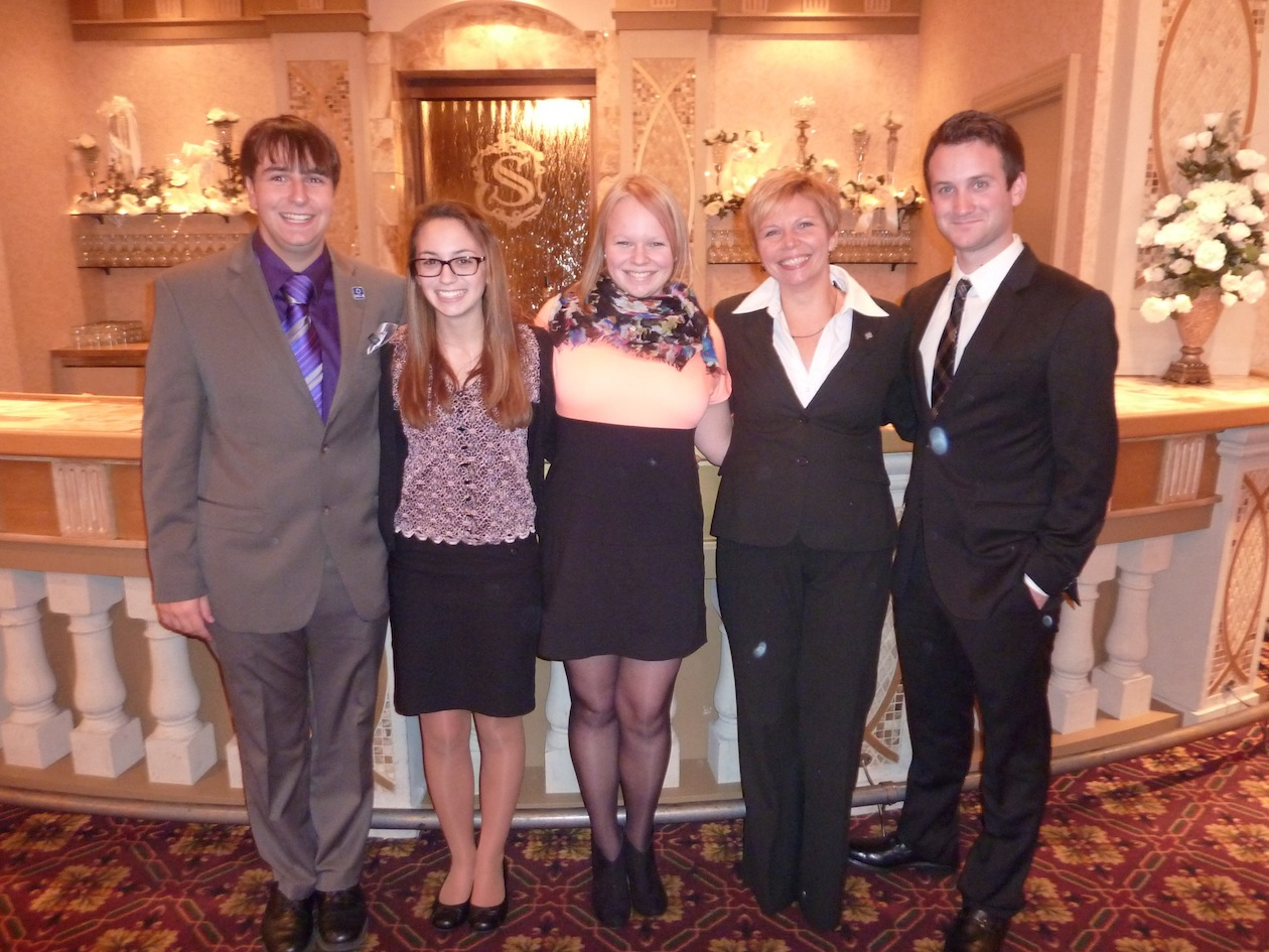 Members of DECA from Grand Island High School were in attendance Wednesday night at Salvatore's Italian Gardens for the Region 12 DECA Installation Dinner and heard GIHS alumnus Corey McGowan as guest speaker. Pictured at the event are, from left: GIHS DECA Treasurer Sam Clarke, Sara Carlson, President Sarah Chamberlain, Advisor Cheryl Chamberlain, and McGowan.