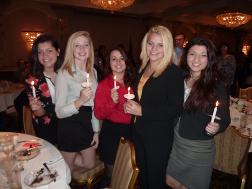 Students at Grand Island High School were inducted into the state and national level of DECA during an event at Salvatore's Italian Gardens on Oct. 22. Pictured, from left are new members MaryKate Petz, Emily Phinney and Jessica Foote, with veteran members Molly Smith and Grace Giambra.