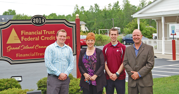 Financial Trust Federal Credit Union. From left: Jack Keefe, loan officer; Kinney; Jason Guether, member service representative; and John Morrison, CEO.