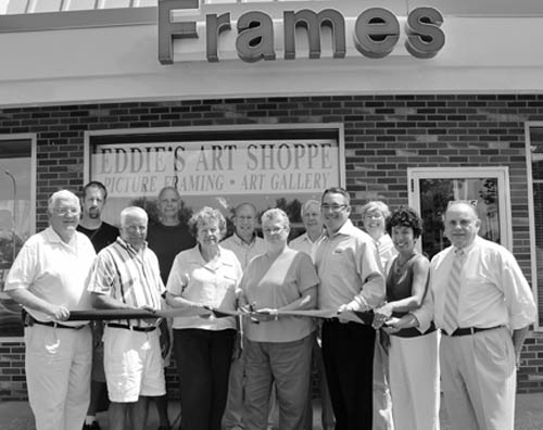 Members of the Grand Island Chamber of Commerce and town officials gathered Tuesday to welcome Linda Feldman, new owner of Eddie's Art Shoppe, at 2305 Grand Island Blvd., and to cut the ceremonial ribbon on her enterprise. From left, front row, Town Supervisor Peter McMahon, Town Councilman Gary Roesch, chamber director Bonnie Sciuk, Feldman, Chamber President Eric Fiebelkorn, chamber director Teresa Costello and chamber past President John Bonora. Back row: chamber director Derk Ostrom, town councilmen Ray Billica and Dick Crawford, chamber director Skip Mazenauer, and Councilwoman Mary Cooke. (photo by Larry Austin)