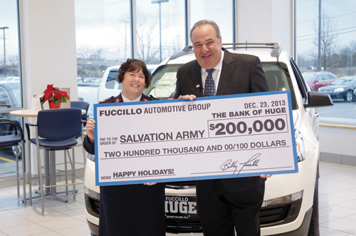 Billy Fuccillo, owner of Fuccillo Automotive Group, presented a check for $200,000 to Maj. Kathleen Applin of the Salvation Army Buffalo Area Services Dec. 23 at Fuccillo Chevrolet on Alvin Road. Fuccillo matched money raised during the Salvation Army's red kettle campaign. (photo by Larry Austin)