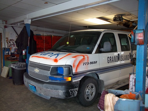 Vandals have spray-painted vehicles and set fires in an attempt to ignite the interior of a Golden Age Center van.