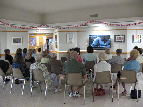 A big-screen television was dedicated in memory of Library Trustee and Friends of the Grand Island Memorial Library Treasurer Scott Smith on Thursday, Aug. 23.