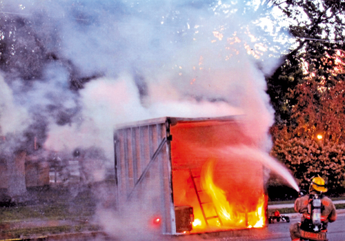 A live fire demonstration at the Fire Prevention Open House simulated a bedroom fire. (photo by Ray Pauley)