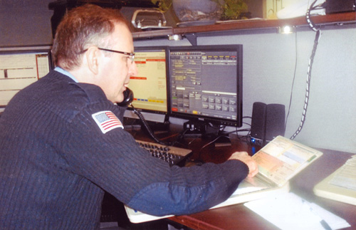 Grand Island Fire Co. Communications Supervisor Steve Morgan handles the first emergency call for help received on the Grand Island Fire Co.'s new 911 system. (photo by Ray Pauley)