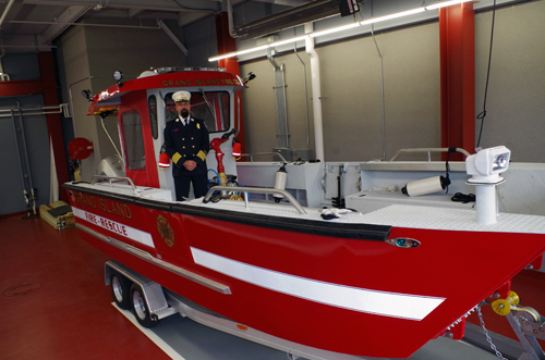 Grand Island Fire Co. Chief Kevin Koch stands aboard the company's new fireboat. (photo by Larry Austin)