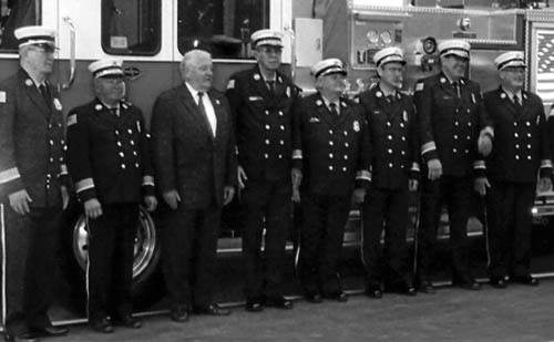The Grand Island Fire Co. held a readiness inspection on Oct. 1. Past GIFC chiefs who attended a company inspection included, from left: Norm Mrkall I, Gary Roesch, Peter McMahon, Ray Pauley, Dave Tolejko, Steve Morgan, Paul Gorman, Norm Mrkall II and Greg Butcher.