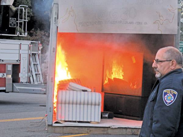 A live fire demonstration showed visitors to the fire company's open house how quickly a living room fire can spread. (photo by Colleen Rebmann)