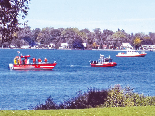 Multiple agencies in joint operation went to the scene off Sandy Beach to answer a call of boaters in the water Tuesday. (photo by Ray Pauley)