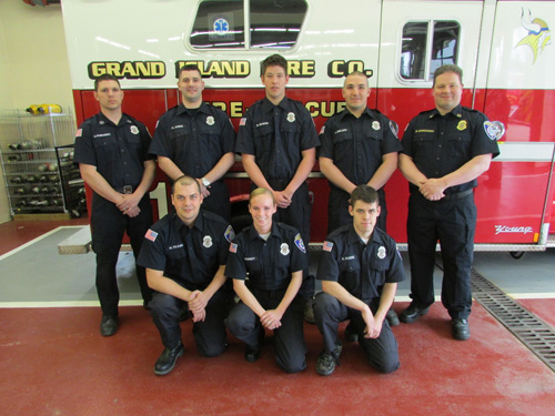 The Grand Island Fire Co. has six new recruits undergoing training so far in 2014. From left, standing: Capt. John Podlucky, Charles Jones, Dakota Bower, Nicholas Egloff, Assistant Chief Mark Sadkowski. Kneeling: Nathan Tilkins, Adrianne Berndt and Seth Kozek. (photo by Ray Pauley)