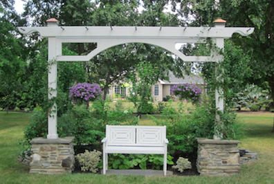 A space for shade in the garden of Jim and Linda Broman of Timberlink Drive was one of many locations on the Historic Trinity Garden Tour. (photo by Alexandra Muto)