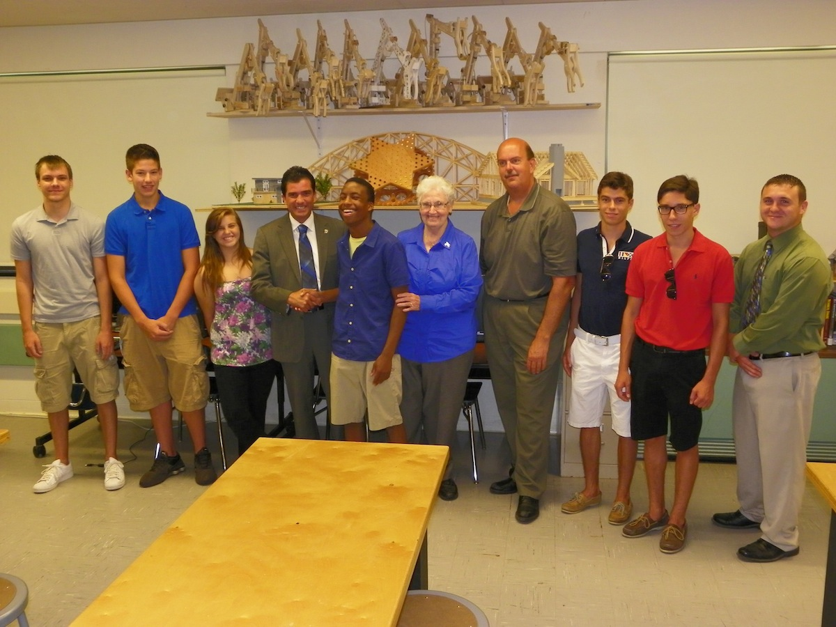 The Grand Island Central School District is the recipient of grant money secured by State Sen. Mark Grisanti, who represents Grand Island in the New York State Senate. Pictured, from left, are Grand Island High School students Zachary Burns, Dakota Bower and Dominique Perri, Grisanti, student Zachary Harper, board of education members Joan Droit and Paul Krull, students Frank DeRubes and Brian DeRubes, and Grand Island High School Project Lead The Way teacher Jonathan Shelley.