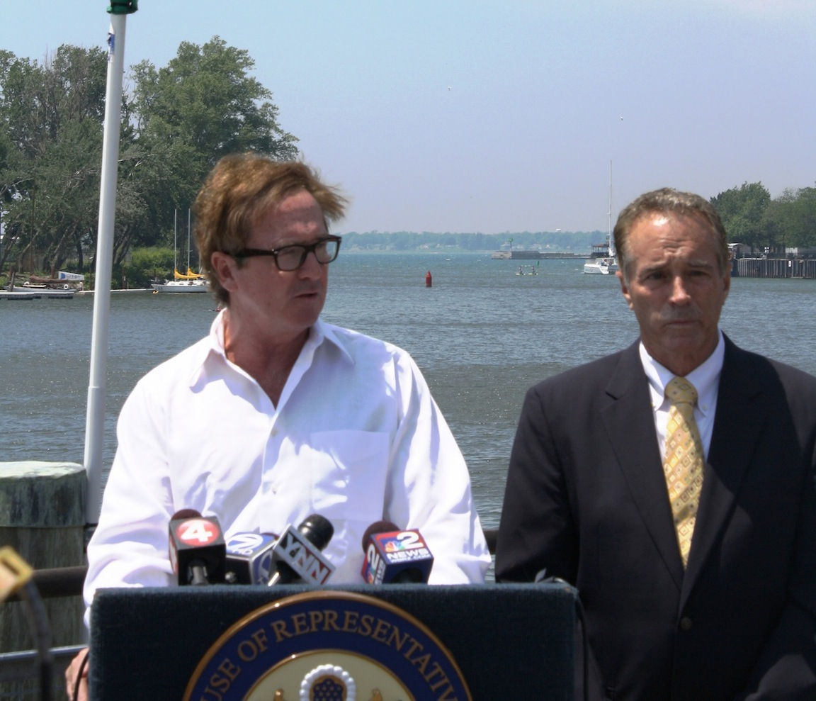 Congressman Brian Higgins and Congressman Chris Collins stand along the Buffalo River.