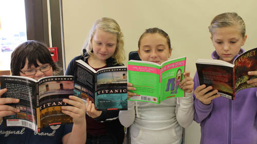 Students at Kaegebein Elementary School, including, from left, Maddie Mesmer, Bethany Wolcott, Gia Dilimone and Miranda Proctor, were the beneficiaries of free books thanks to the Kaegebein PTA's involvement in `Hooked on Books!`