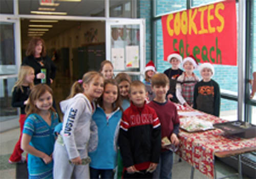 Huth Road School students man the sales table as classmates purchase their holiday treats.