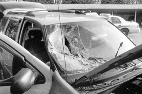 A car suffered severe windshield damage after a collision with a building on Sunday.
