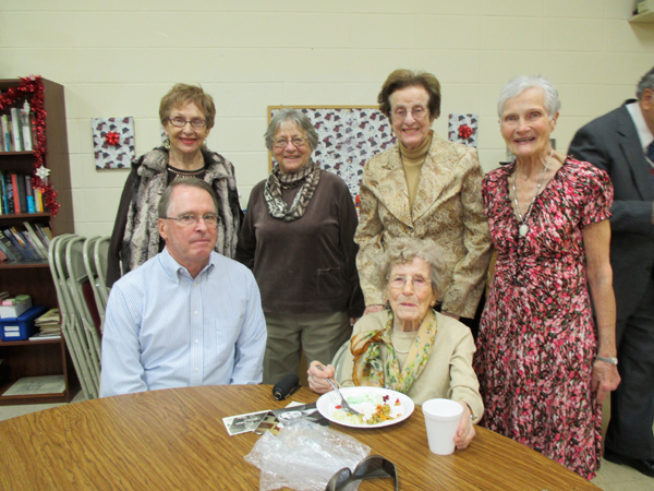 Jean Wholahan celebrated her 100th birthday at Island Presbyterian Church Nov. 30. Photo No. 1: Pictured, sitting: Clifford Wholahan and Jean Wholahan. Standing, from left: Joan Photiadis, Sally Stubinger, Barbara Libby and Dorothy Westhafer. Photo No. 2: Daisy Moore, chair of the birthday party, enters the Fellowship Hall with Wholahan. (photos by Lee Tetkowski)