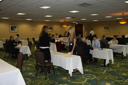Job Search at the Holiday Inn Grand Island included tough interviews in an authentic setting. Pictured at left, Cheryl Cardone shaking Alyssa Cino's hand during the interview process.