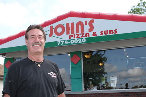 Mark Raepple, one of the partners of John's Pizza & Subs, is pictured at the restaurant on Grand Island Boulevard. John's Pizza & Subs is celebrating its 30th anniversary of business. (photo by Larry Austin)