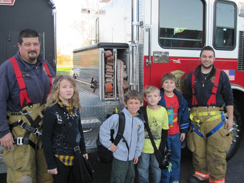 Pictured with GIFC personnel are Gabrielle Ducette, William Worral, Dominick Kane, and Jayce Claus.