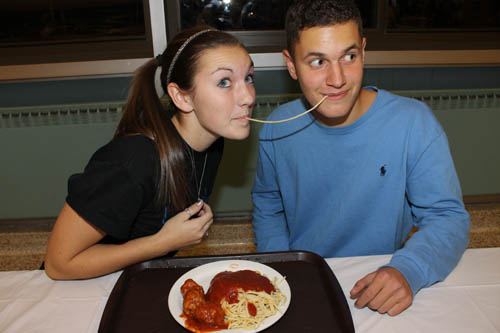 Seniors Danyelle Redmond and Dominic Morell of Grand Island High School's National Honor Society share a plate of pasta during the NHS spaghetti dinner last Friday. (photo by Larry Austin)