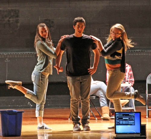 Grand Island High School students are preparing to perform the musical `Les Misérables` Feb. 2, 3 and 4. From left, Rachel Ripellino, Nick Winger and Mads Goc rehearse the song `Master of the House` from the show. (photo by Larry Austin)