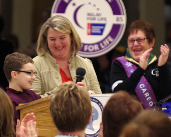 Above, 8-year-old Luke Gworek was named the 2015 honorary survivor for the GI Relay, and his family members, represented above by his mother, Danielle, were named honorary caregivers. (photo by Larry Austin)