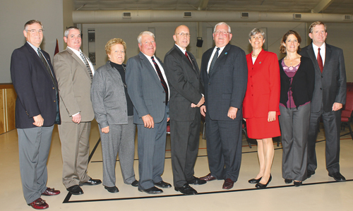 Candidates for town and county offices gathered for a photo following Meet the Candidates Night on Oct. 20 at the Family Life Center. From left: candidates for Grand Island Town Council Jim Sharpe and Norm Moorhouse; Town Justice Sybil Kennedy; candidates for Town Council Gary Roesch and Dick Crawford; candidates for town supervisor Pete McMahon and Mary Cooke; Town Clerk Pattie Frentzel; and candidate for County Legislator Kevin Hardwick. Not pictured is candidate for legislator Jeremy Zellner. (photo by Larry Austin)