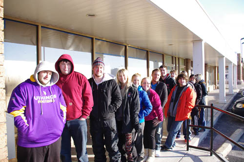 Patrons of the new Mighty Taco restaurant in the Grand Island Plaza wait by the door on the first day of business. Some camped out overnight to be among the first in line at the restaurant. (photo by Larry Austin)