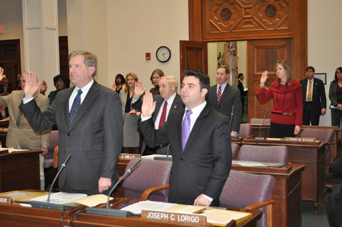 The Erie County Legislature's Minority Caucus, including Legislator Kevin Hardwick, left, and Legislator Joseph Lorigo, take the official oath of office during the annual reorganizational meeting held Jan. 5. Legislator John Mills was named minority leader during the meeting.