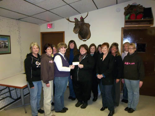 The Women of the Moose purchased a brick to support construction of an adaptive baseball diamond on Grand Island, an endeavor of The Miracle League of Grand Island and Western New York. The Miracle League's Fran McMahon, center, receives the donation from members of the WOTM.