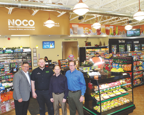 NOCO Express is open for business at the new store at the intersection of Grand Island Boulevard and Whitehaven Road. Pictured Tuesday are, from left, NOCO General Manager Jim DeFilippis, Store Manager Josh Mueller, District Manager Pete Smith and Executive Vice President Mike Newman. (photo by Larry Austin)