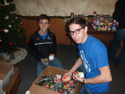 Brentyn Mendel and Brian DeRubes of Grand Island High School sort donated canned goods for the Neighbors Foundation.