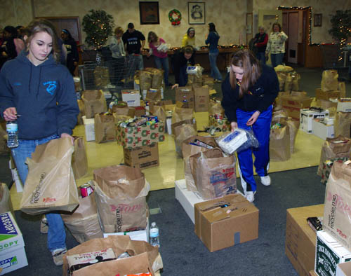 Volunteers sorted approximately 4,500 pounds of food at the Knights of Columbus hall on Whitehaven Road Tuesday as part of the Grand Island Neighbors Foundation's annual Christmas food drive. (photo by Larry Austin)