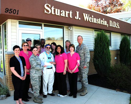 Pictured, from left: Megan Calero, 914th Airlift Wing life/work consultant; Susan Yuoroshoski; Gregory Hood, retired master sergeant; Capt. Gina Pizziconi-Cupples, 914th Logistics Readiness Squadron commander; Wendy Mariano; Ron Bassham, retired staff sergeant; Dr. Stuart Weinstein; Laura Hood; Marygrace Scarpelli; Lana Swartzmiller; Carla Siwinski; and Col. Allan Swartzmiller, 914th Airlift Wing commander.