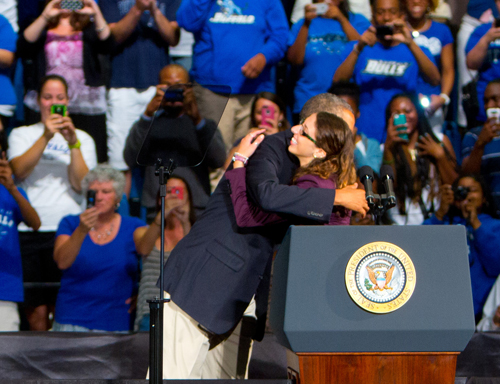 President Barack Obama gives Grand Islander Silvana D'Ettorre a hug after she introduced him at the University of Buffalo's Alumni Arena prior to his address on college affordability Thursday.